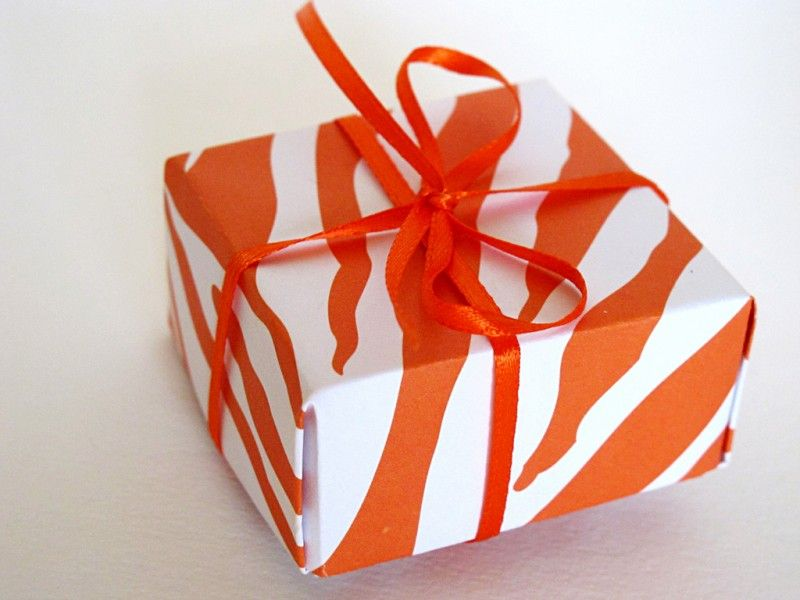 Origami gift box made with orange zebra paper. Photo: Ivella.
