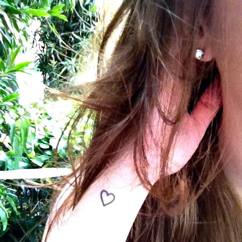 Heart tattoo on the wrist.